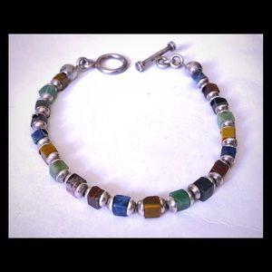 Multi-gemstone bracelet with silver tone findings